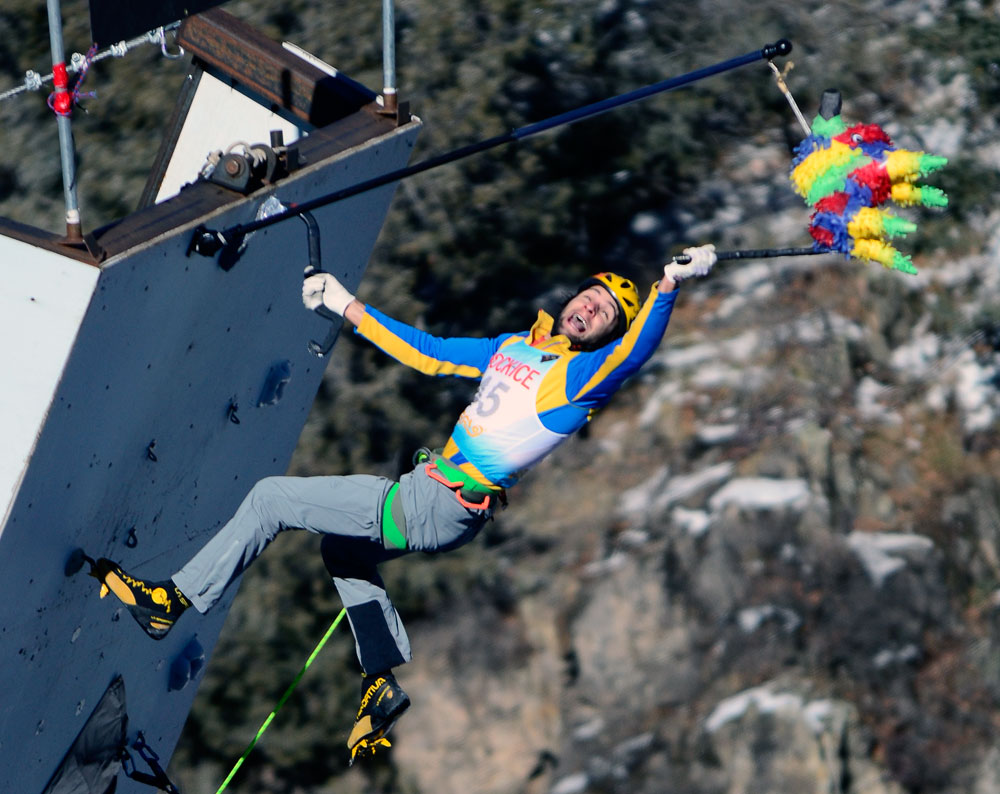 Mauro Dorigatti of Italy tags the pinata to take second place a the 2014 Ouray Mixed Competition. He bested Will Mayo by just half a second.